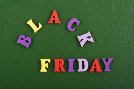 BLACK FRIDAY word on green background composed from colorful abc alphabet block wooden letters, copy space for ad text. Learning english concept.
