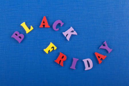 BLACK FRIDAY word on blue background composed from colorful abc alphabet block wooden letters, copy space for ad text. Learning english concept.
