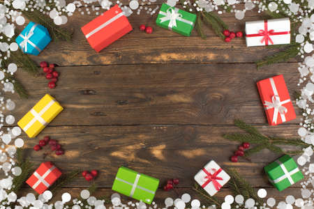 Gift boxes and colorful present for christmas on wood table. Top view with copy space. Banco de Imagens