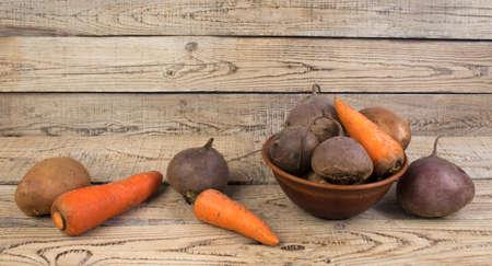 Organic vegan food. potato, beet, carrots on wooden background. country style. Zdjęcie Seryjne