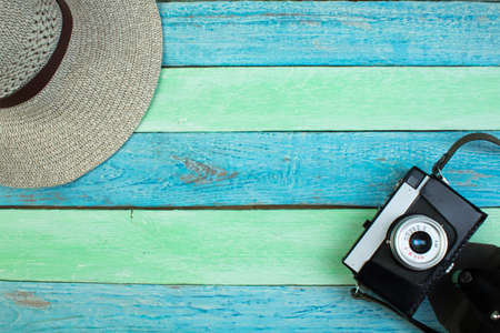 camera on Wooden Background - Beach Summer Holiday. Top view and copy space.