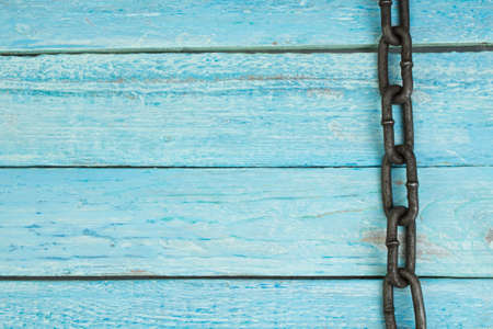 wooden background with chain. Copy space for text.