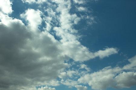Blue, clear sky with clouds and sun. Zdjęcie Seryjne