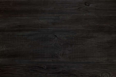black Wood texture background. Hardwood, wood grain, organic material grunge style. Vintage wooden surface top view. Wooden table top view. Copy space for text.
