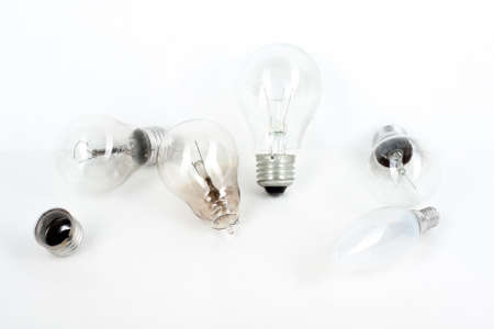 old-fashioned glass light bulbs are on a white table.