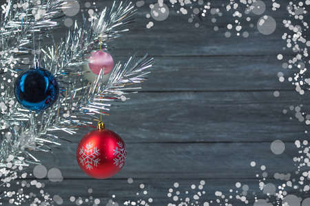 Christmas composition of fir branches and Christmas balls of viburnum on a wooden background .