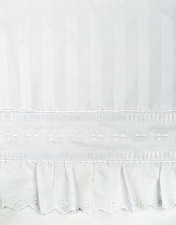 background of white embroidered fabrics, decorative lace.