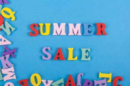 Summer sale word on blue background composed from colorful abc alphabet block wooden letters, copy space for ad text. Learning english concept. Zdjęcie Seryjne