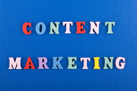 CONTENT MARKETING word on blue background composed from colorful abc alphabet block wooden letters, copy space for ad text. Learning english concept.