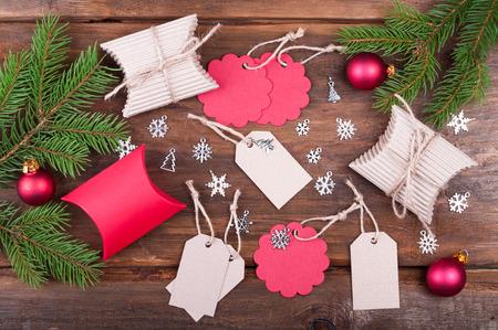 handmade christmas gift tags and christmas gift boxes on wooden table background christmas tree branch - Christmas Tags Handmade
