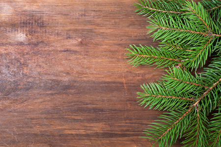 Christmas background. Christmas tree on old wooden board. Top view