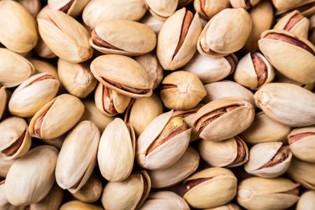 Pistachios nuts background. Pistachio texture. Top view