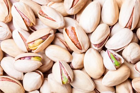 Pistachios background. Pistachio texture closeup. Nuts. Top view