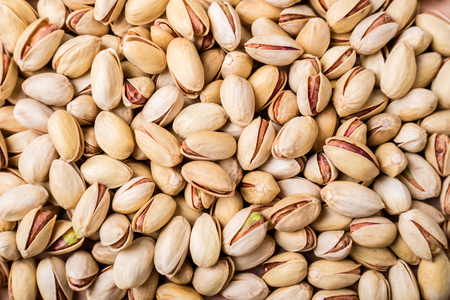 Pistachios nuts background. Pistachio texture. Top view Stock Photo - 115147363