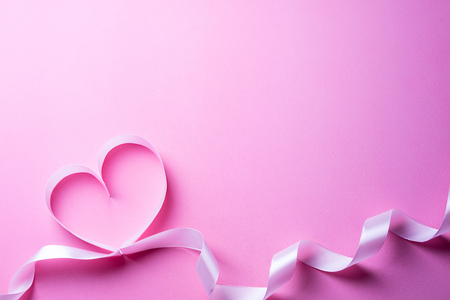 Valentines Day background with pink heart. Heart shape from ribbons. Top view and copy space