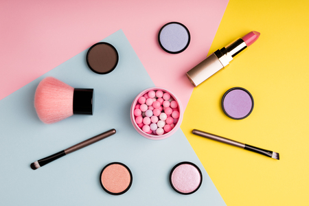 Makeup products and decorative cosmetics on color background flat lay. Fashion and beauty blogging concept. Top view Zdjęcie Seryjne