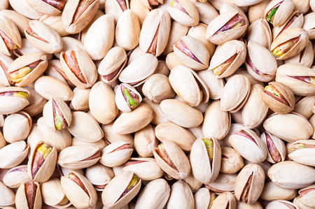 Pistachios background. Pistachio texture. Nuts. Top view Archivio Fotografico - 115147465