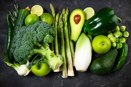 Variety green vegetables and fruits. Healthy food vegetables and fruits, dieting, clean eating, detox concept. Top view