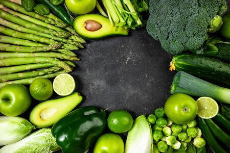 Healthy food clean eating green vegetables and fruits on dark stone background. Green vegetables. Healthy food, healthy lifestyle, dieting, detox concept. Copy space Stok Fotoğraf