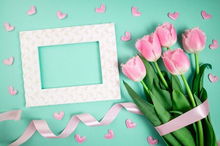 Bouquet of tulips flowers on color festive background. Spring flowers on floral card flat lay. Greeting card, holidays concept. Copy space