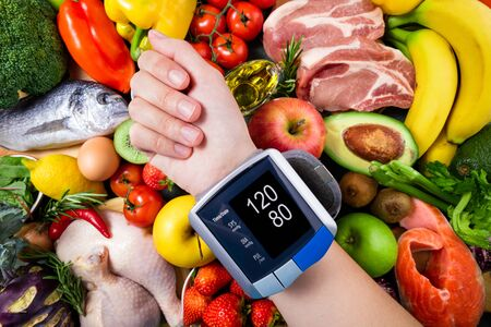 Background healthy food for controlling blood pressure. Fresh vegetables, fruits, fish, and berries. Healthy food, diet and healthy life concept. Top view