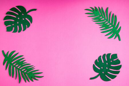 Summer trendy background with leaves on pink. Handmade palm leaves. Felt toy. Idea summer art crafts for kids in camp arts. Top view
