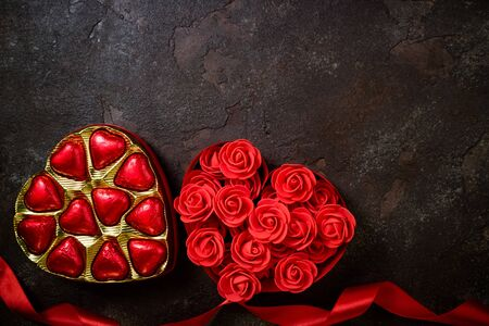 Valentines Day background with red heart and chocolate bonbons. Heart shape from ribbons and flowers rose. Happy Valentine Day 版權商用圖片