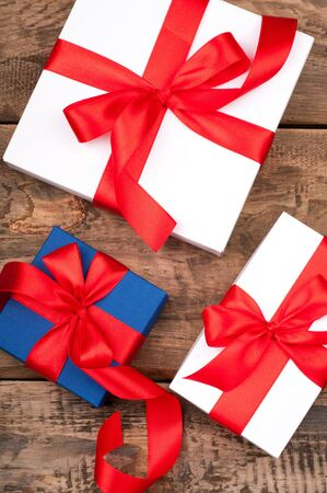 Christmas gift boxes on rustic wooden background. Holidays presents