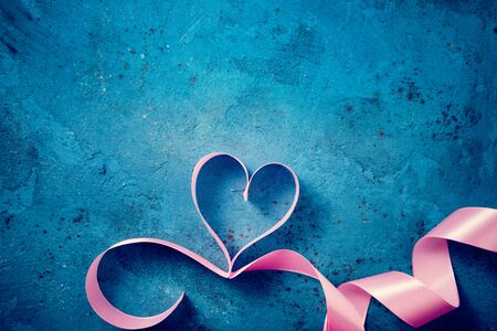 Valentines Day background with pink heart. Heart shape from ribbons. Happy Valentine Day