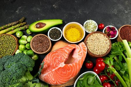 Flat lay of healthy food. Selection of healthy eating fish, vegetables, beans, antioxidants and sources of omega 3. Healthy food for heart, diet and healthy lifestyle concept. Top view