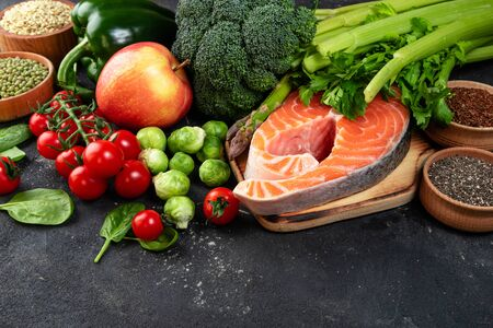 Variety of healthy food. Selection of healthy eating fish, vegetables, fruits and berries. Healthy food for heart, keto diet and healthy lifestyle concept. Copy space