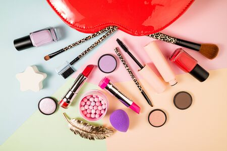 Stylish trendy makeup products and decorative cosmetics for female make up. Fashion, makeup, feminine concept top view 版權商用圖片