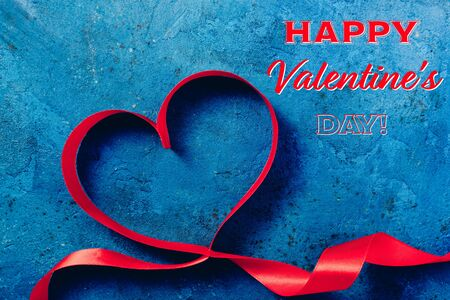 Happy Valentine Day card. Valentines Day background with red heart. Heart shape from ribbons 版權商用圖片