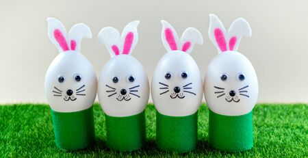 Happy Easter background. Creative Easter egg decoration ideas with easter bunny. Funny Easter eggs cute bunny. Spring compositions