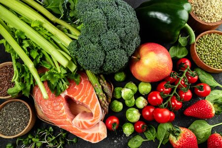Variety of healthy food. Selection of healthy eating fish, vegetables, fruits and berries. Healthy food for heart, keto diet and healthy lifestyle concept 版權商用圖片