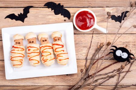 Funny sausage mummies with ketchup for Halloween. Top view Archivio Fotografico