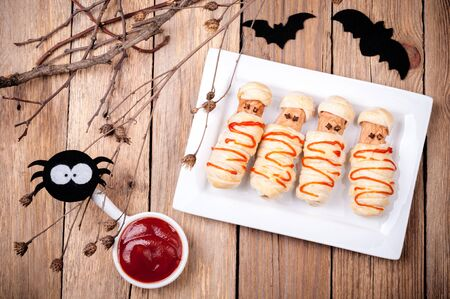 Funny sausage mummies with ketchup for Halloween. Top view 版權商用圖片