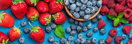 Fresh berries strawberry, blueberry, raspberry. Various fresh summer berries. Top view