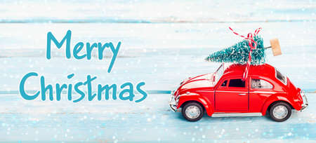 Christmas background with red car and Christmas tree. Merry Christmas holidays greeting card. Long format for banner