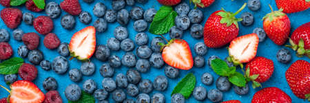 Fresh berries strawberry, blueberry, raspberry. Various fresh summer berries. Long format