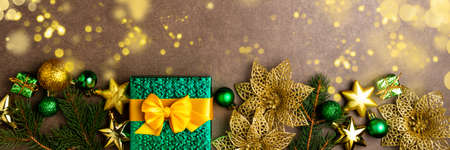 Christmas background with gift box, lights and decorations on dark background. Holidays, Christmas, celebration concept. Long format for banner Banque d'images