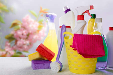 Colorful cleaning set for different surfaces in bathroom, kitchen and other. Spring cleaning, cleaning service concept. Copy space