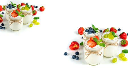 Fresh yogurt with berries in glass jars. Dairy products. Healthy food, dieting and breakfast concept. Long format for banner with copy space