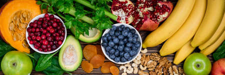 Background healthy food for health heart. Healthy food, diet and life. Fresh fruits and vegetables, berries and nuts. Long format