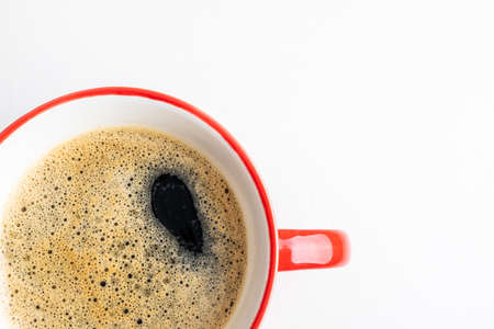 Coffee espresso in red cup. Coffee cup on white background closeup. Morning, breakfast, energy, coffee break concept. Top view