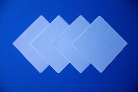 Blue square stikers arranged as an arrow on the dark blue background.
