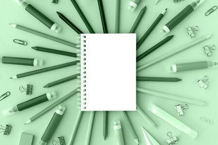 Back to school background with opened notepad and variety of school supplies in trendy neo mint color. Flat lay. Close-up. Copy space.