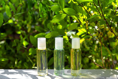Cosmetic display on green leaves and natural stone backdrop. Natural cosmetics and beauty concept. Cosmetic products advertising backdrop. Cosmetic banner design. Reklamní fotografie