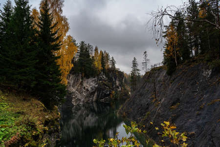 Beautiful autumn mountain lake and forest wild landscape. Autumn forest and lake background. Great design for any purposes.