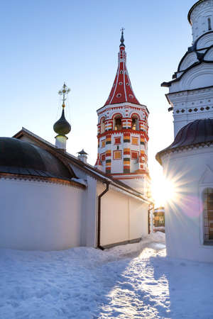 Beautiful background white church and church with colorful ornaments on winter day at sunset. Winter background.